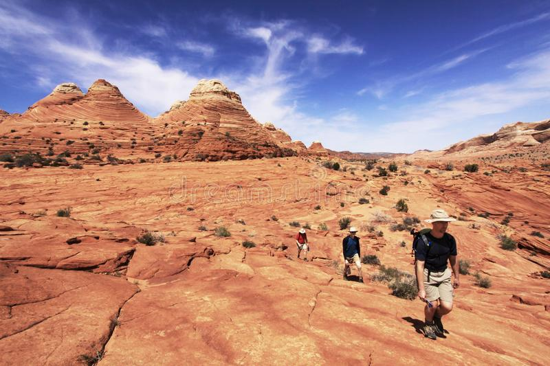 Download Three Hikers En Route To The Wave Stock Photo - Image of coyote, paria: 14328800