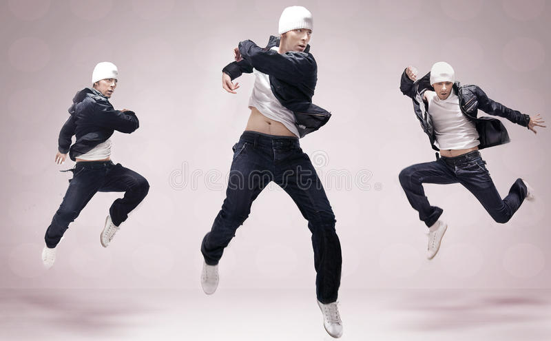 Three hip-hop dancers. Three hip-hop handsome dancers jumping royalty free stock photography