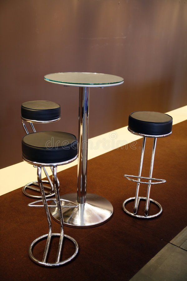 Three hokers by the table royalty free stock photos