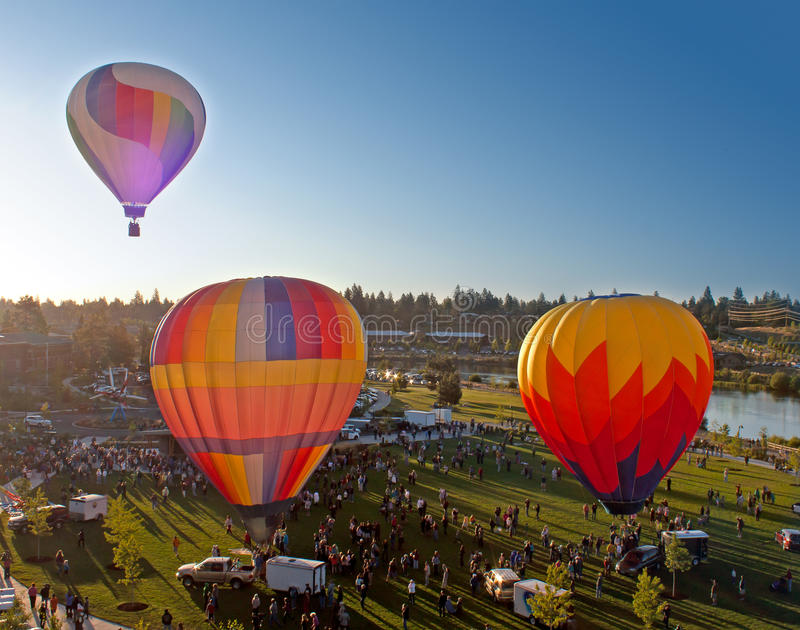 Three Hot Air Balloons Launching Over Bend Oregon royalty free stock photography