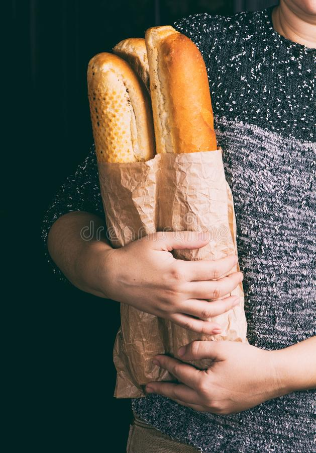 Baguette in hand royalty free stock images