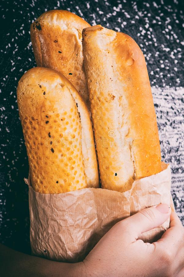 Baguette in hand royalty free stock photos