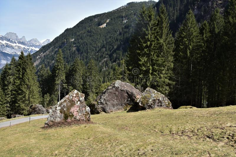 Three huge stones covered with moss close to the tourist path towards to Murg lakes royalty free stock photo