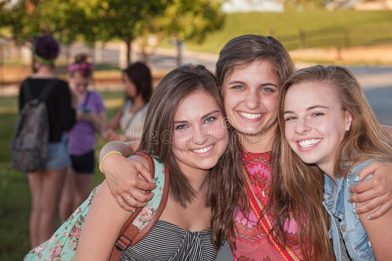 Three Hugging Friends royalty free stock photography