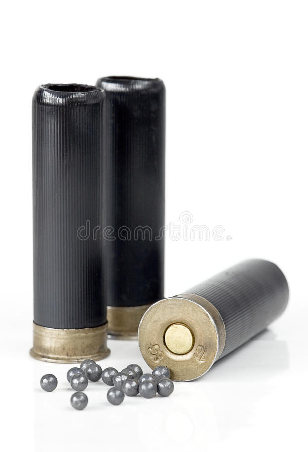Three hunting cartridge and lead shot stock photos