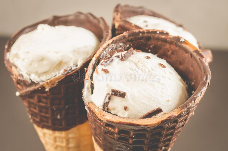 Three ice cream with cone in chocolate/three ice cream with cone in chocolate, close up. Three ice cream with cone in chocolate/ three ice cream with cone in royalty free stock images