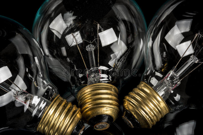 Three incandescent light bulb close up royalty free stock image