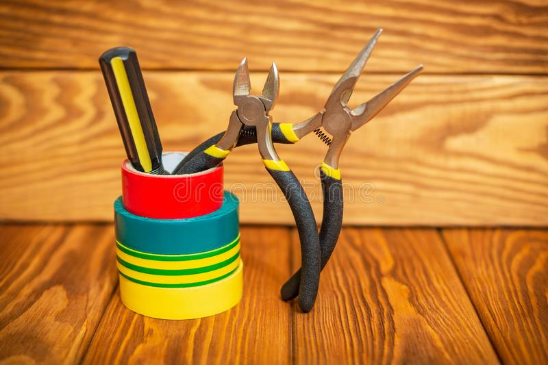 Three insulating tape for electrician on wooden boards stock photography