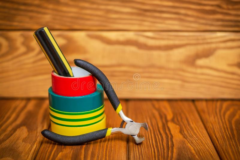 Three insulating tape for electrician on wooden boards royalty free stock images