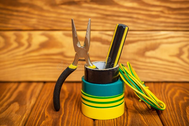 Three insulating tape for electrician on wooden boards stock image