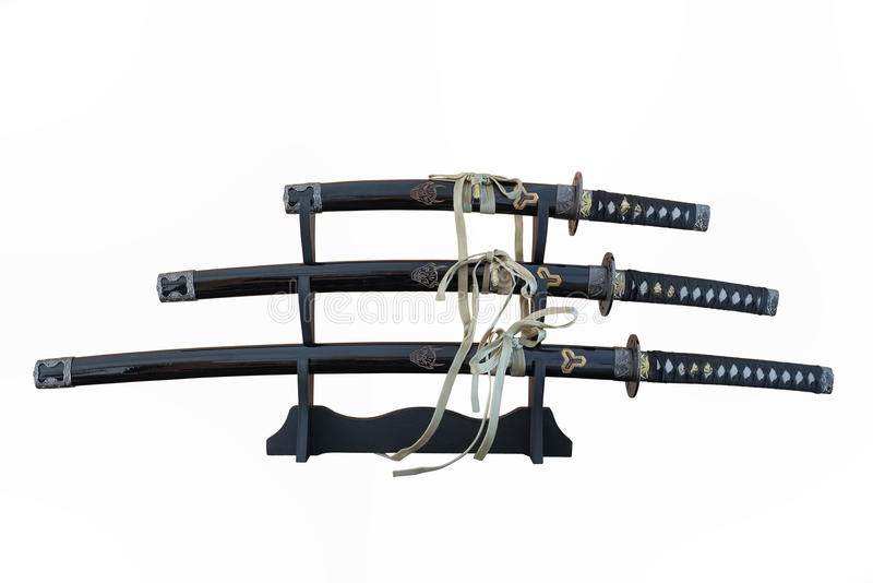 Three isolated Katana`s on the Stand royalty free stock images