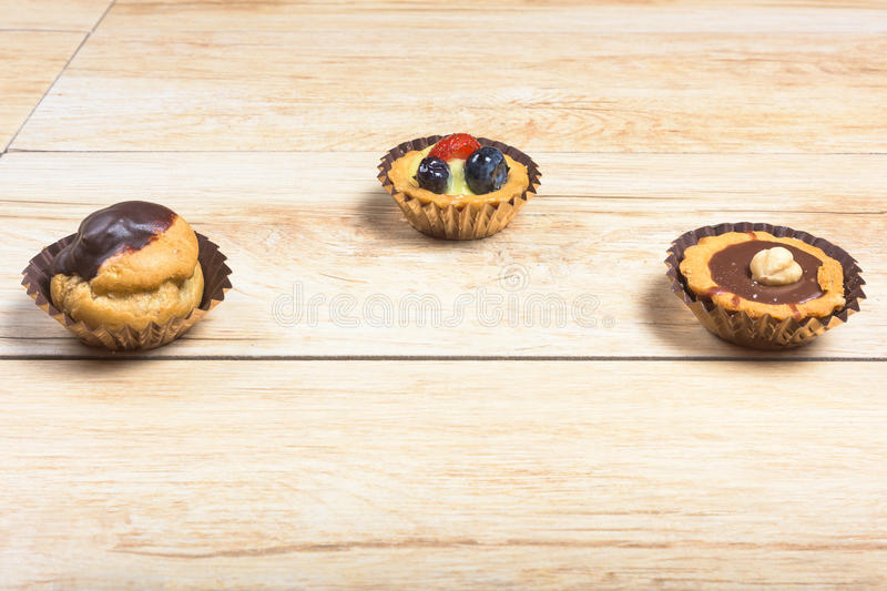 Three italian pastries close-up. Pictured pastries on light wood background stock photo