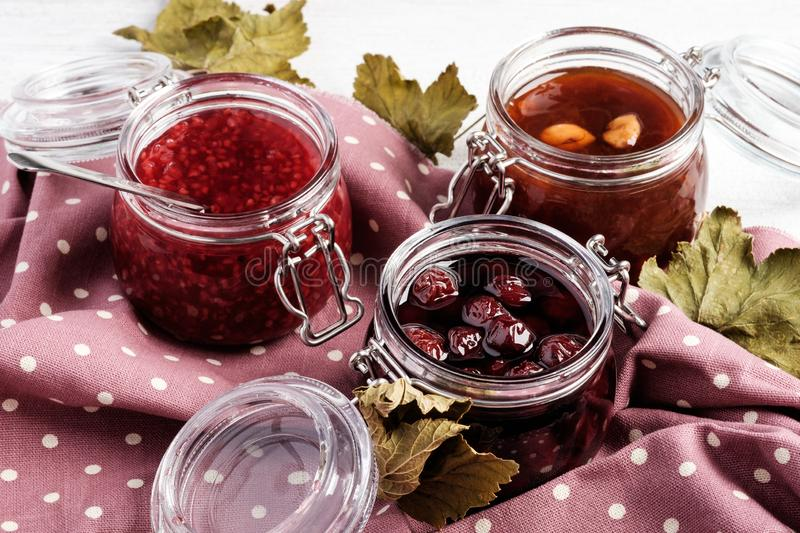 Three jars with jam stock images