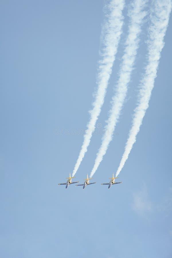 Three jet airplanes performing aerobatic stunt stock images