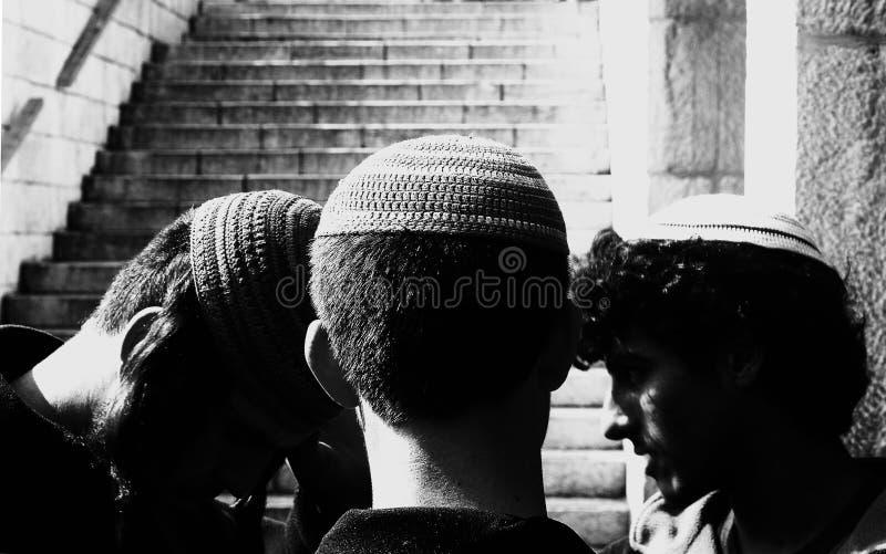 Three jewish religious boys praying royalty free stock photos