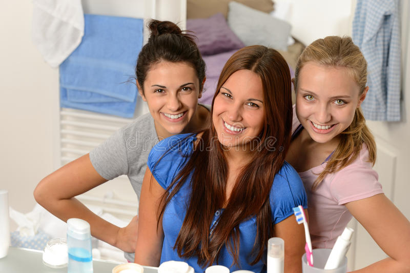 Three young girl friends posing in bathroom royalty free stock images