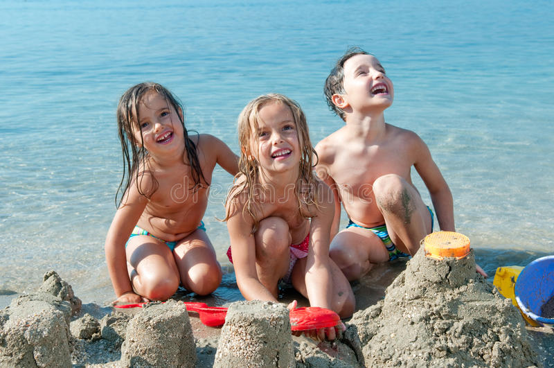 Three kids at the beach stock photography