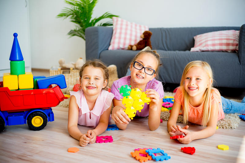 Three kids in daycare stock images