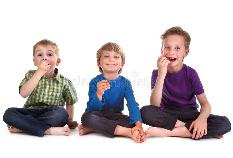 Download Three kids eating sweets stock photo. Image of drops - 19847574