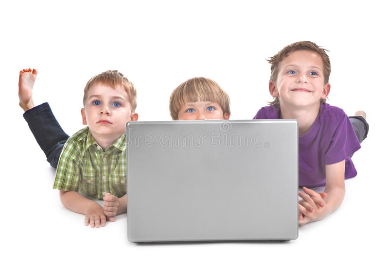 Three Kids With Laptop Stock Photo