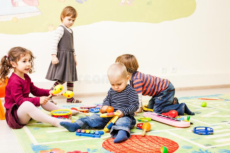Three kids playing with toys stock photos