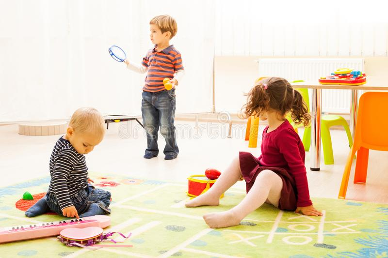 Three kids playing with toys royalty free stock image