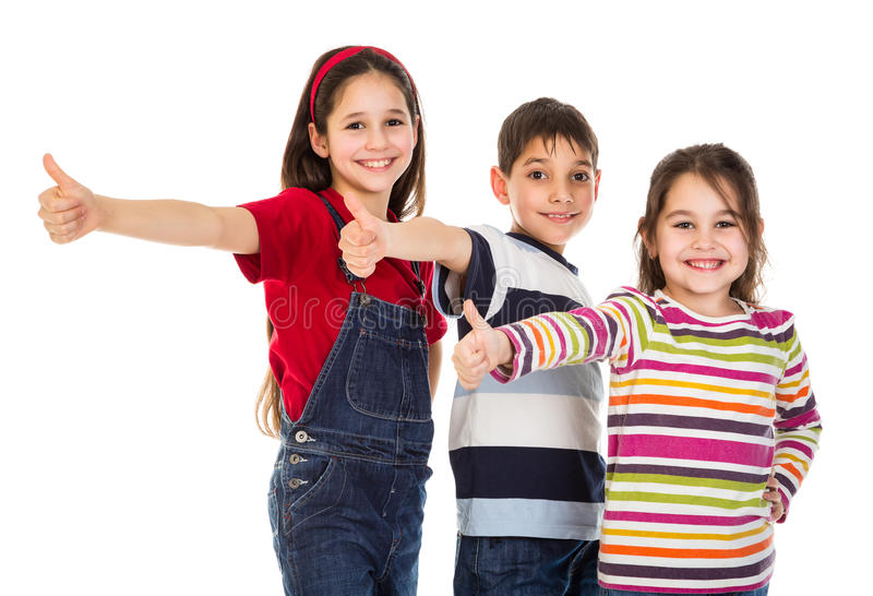 Three kids with thumbs up sign. Three funny kids with thumbs up sign, isolated on white stock photography
