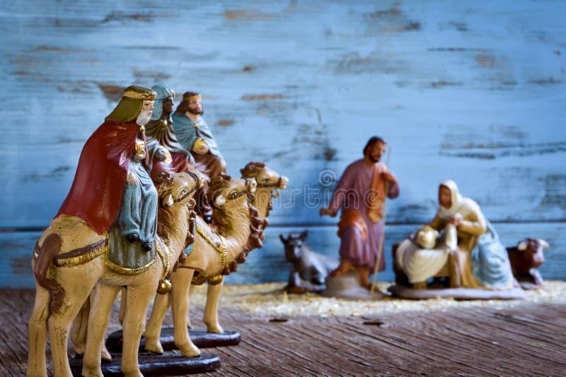 The three kings and the holy family. The three kings on their camels and the holy family in a rustic nativity scene stock photo