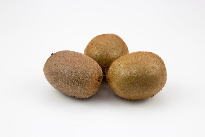 Three kiwi fruits on background. Three fresh, healthy, ripe kiwi fruits on white background. multiple uses are possible royalty free stock photos