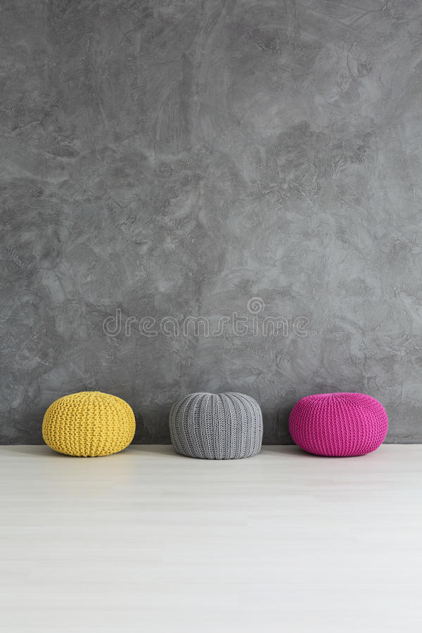 Three knitted poufs stock photography