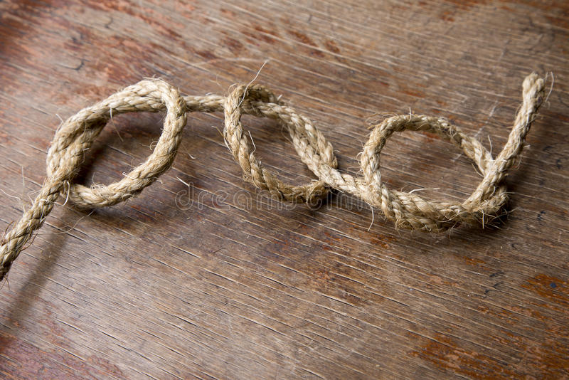 Three knots on old wooden board stock photography