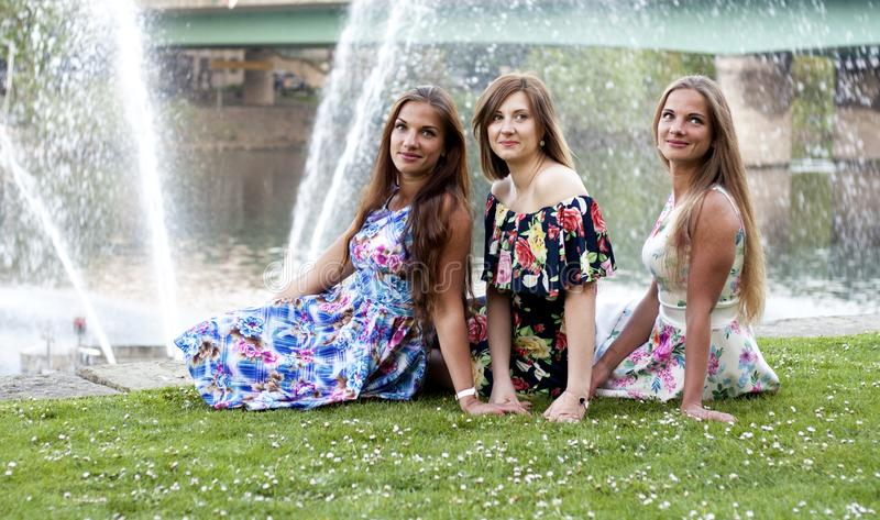 Three ladies in front of water fountain. having fun royalty free stock photo