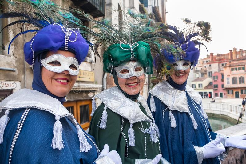 Three ladies wearing costumes for carnival. Three ladies wearing traditional mask and costumes for Venice carnival which takes place each year before Lent.n royalty free stock photography