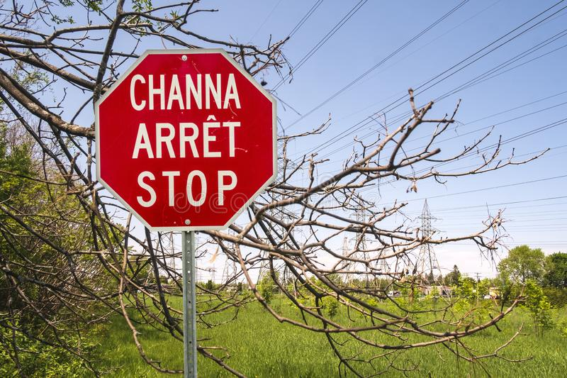 Three language stop sign. Abenakis, French , English Stop sign in a Abénakis region in Odanak, Quebec, Canada. Discover the Mus stock image