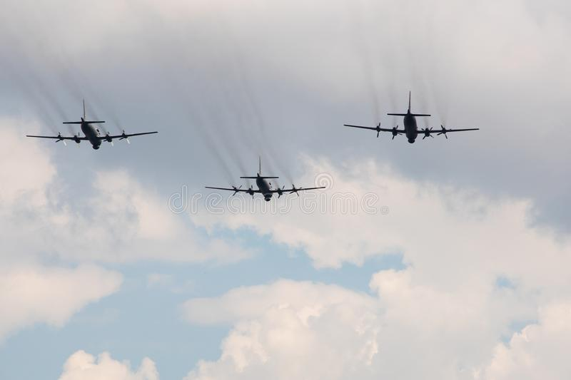 Three large military aircraft with a jet stream stock image