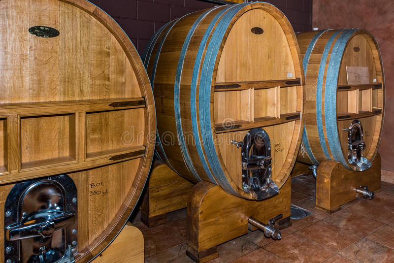Three large wine vats with spigot. Wine celler with three large wine vats with serving spigots royalty free stock image