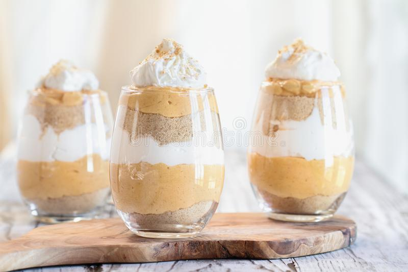 Three Layered Pumpkin Trifle with Whipped Cream and Cookie Crumbs royalty free stock photo