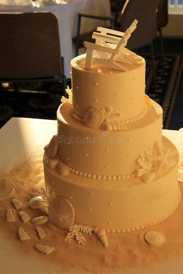 Three Layered Wedding Cake With Beach Theme On Table Stock Image - Layered Wedding Cake