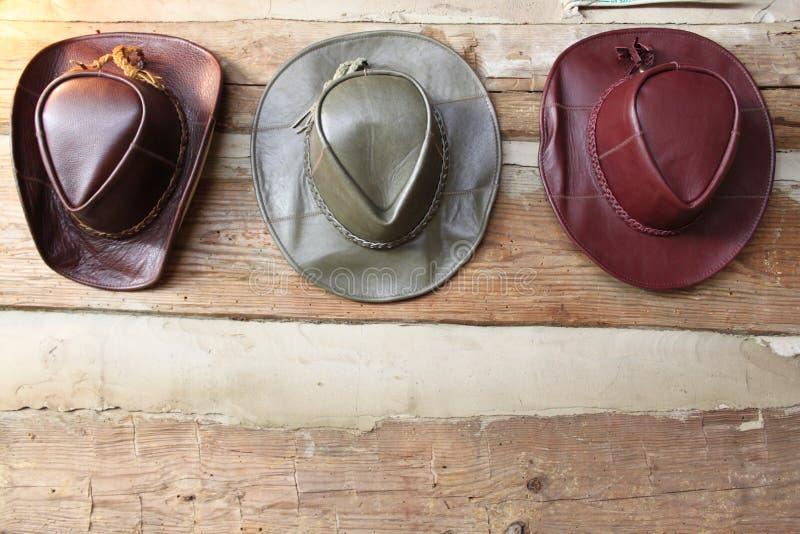 Three leather cowboy hats stock photo