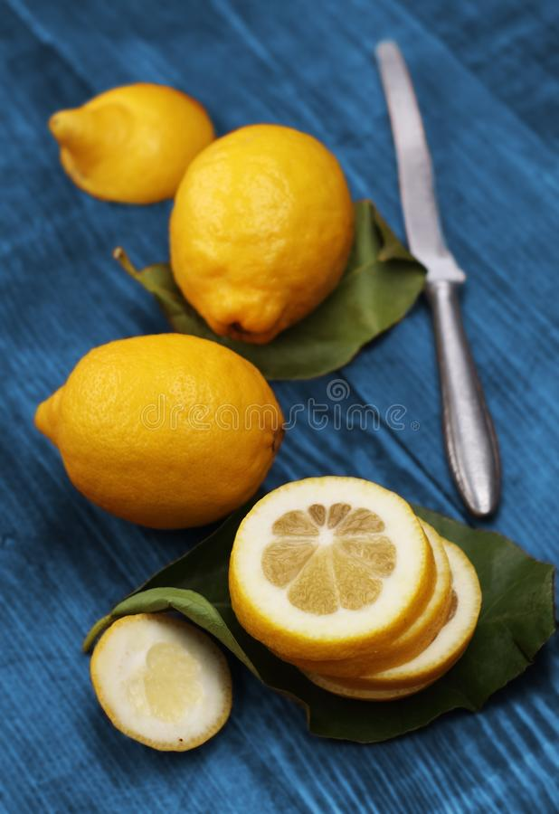 Three lemons on sheets. On a blue countertop royalty free stock photos