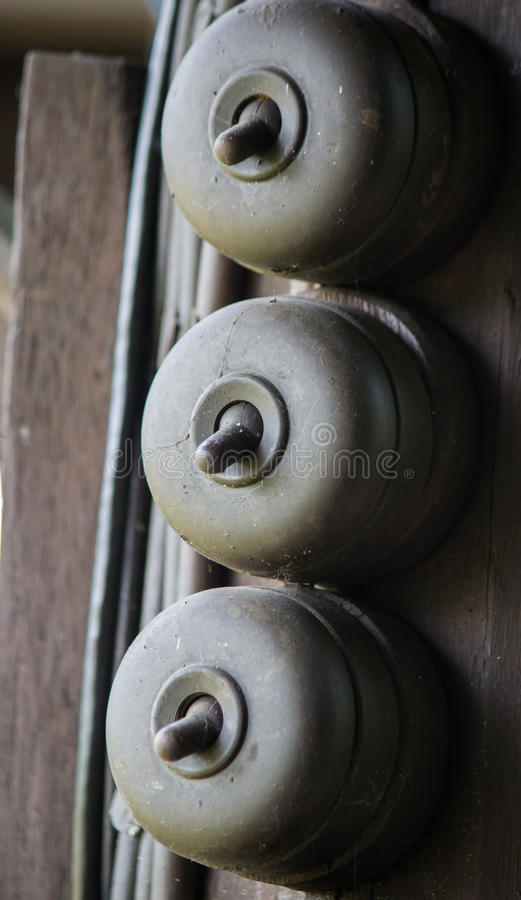 Three Light switches in vintage style. Old style Switches in old Thai house royalty free stock image