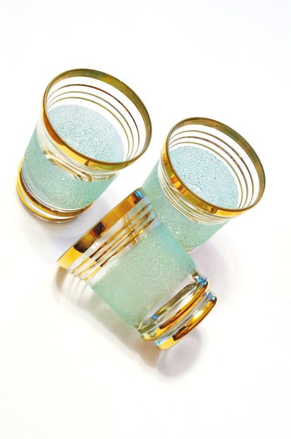 Three liqueur glasses royalty free stock photo