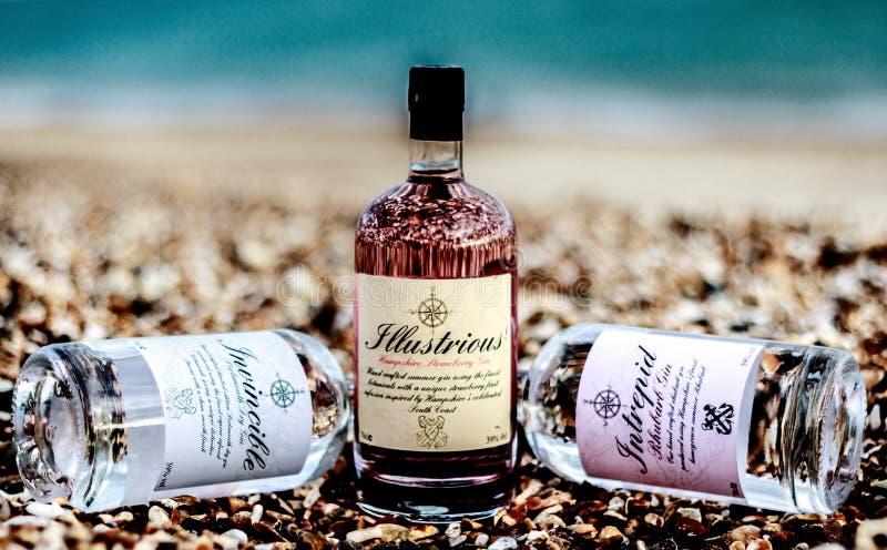 Three Liquor Bottles on Brown Rocks stock photography