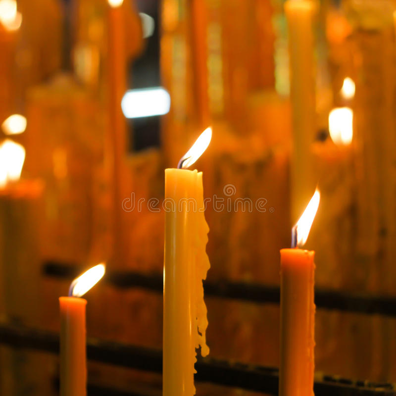 Three Lit Candles. In temple stock image