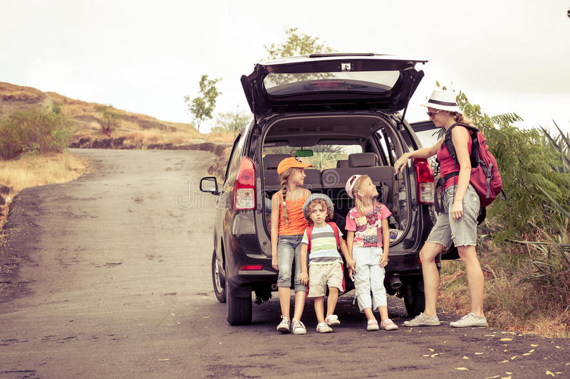 Three little kids and mother in the mountains royalty free stock image