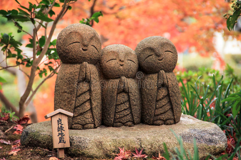 Three little monk rock carving statue in autumn royalty free stock photo