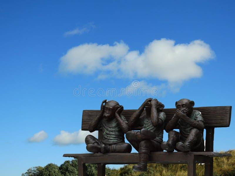 Three little monkeys sculpture stock images