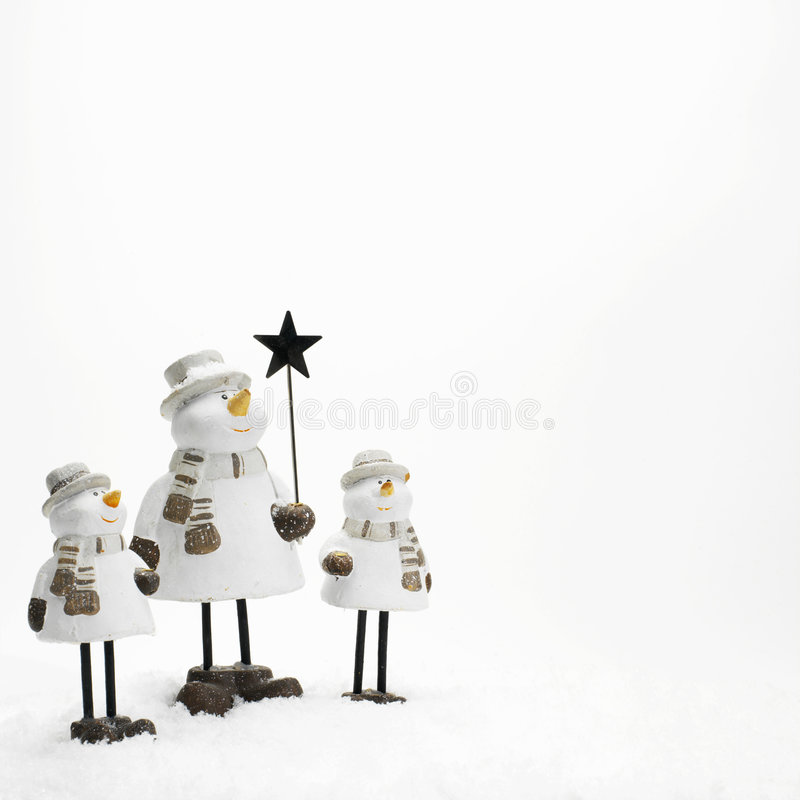 Three little snowmen royalty free stock images