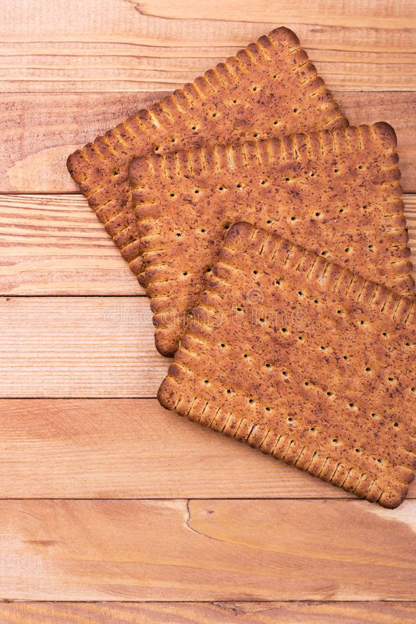Three loaves of breadstick, space for text. Crispy breadstick on wooden background stock photo