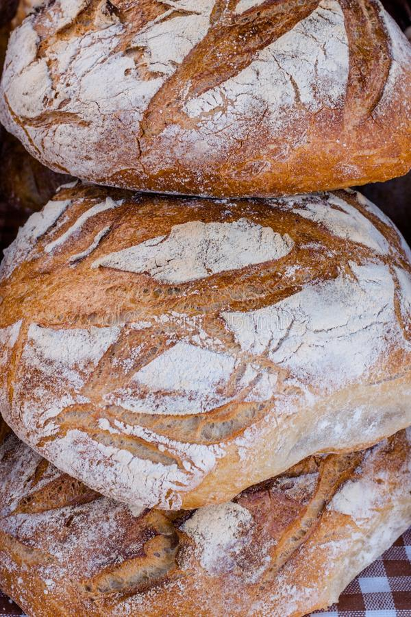 Three loaves of rustic sourdough bread, close up stock photo